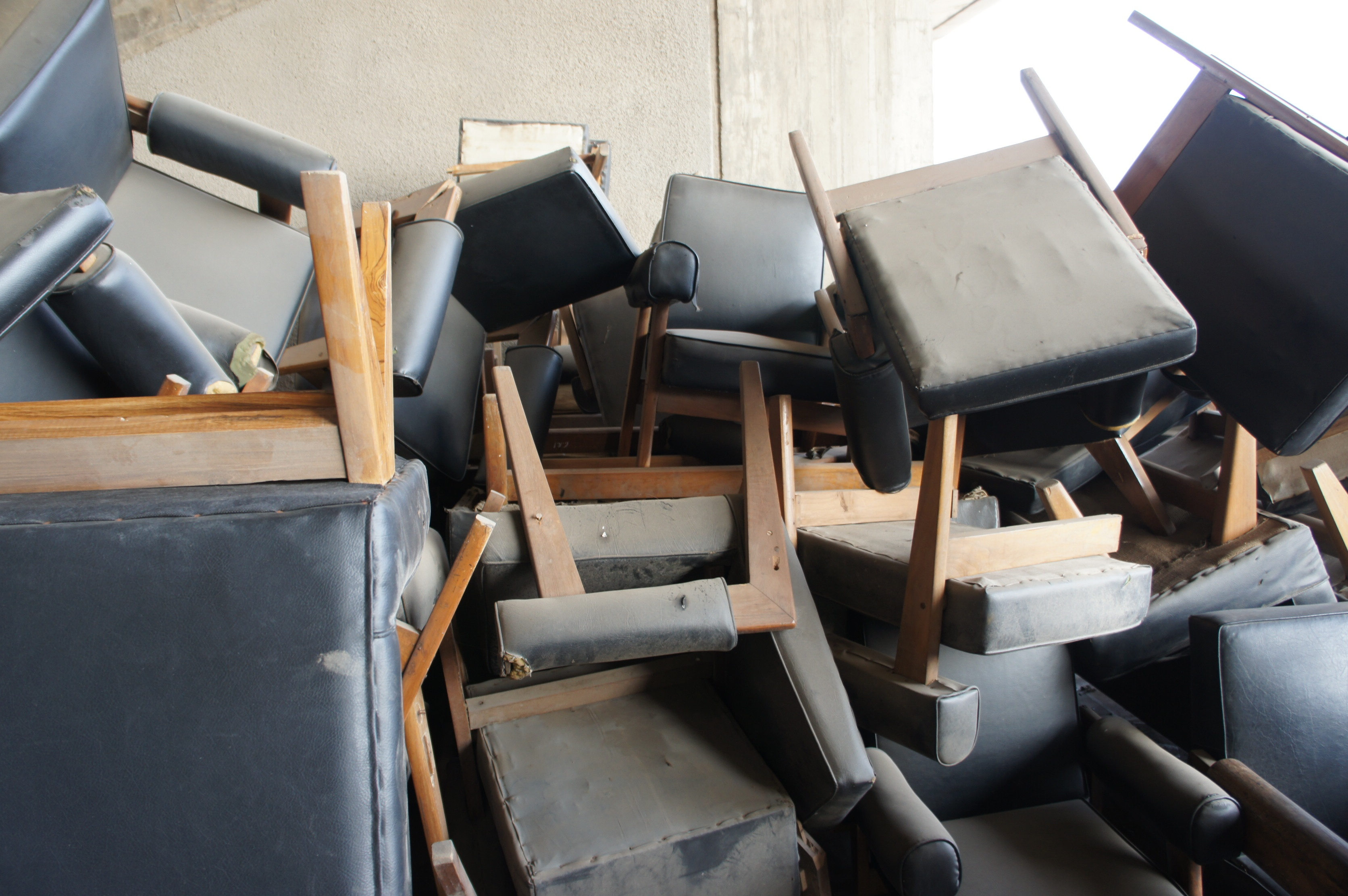 Original furniture piled in storage at the High Court, Sector 1